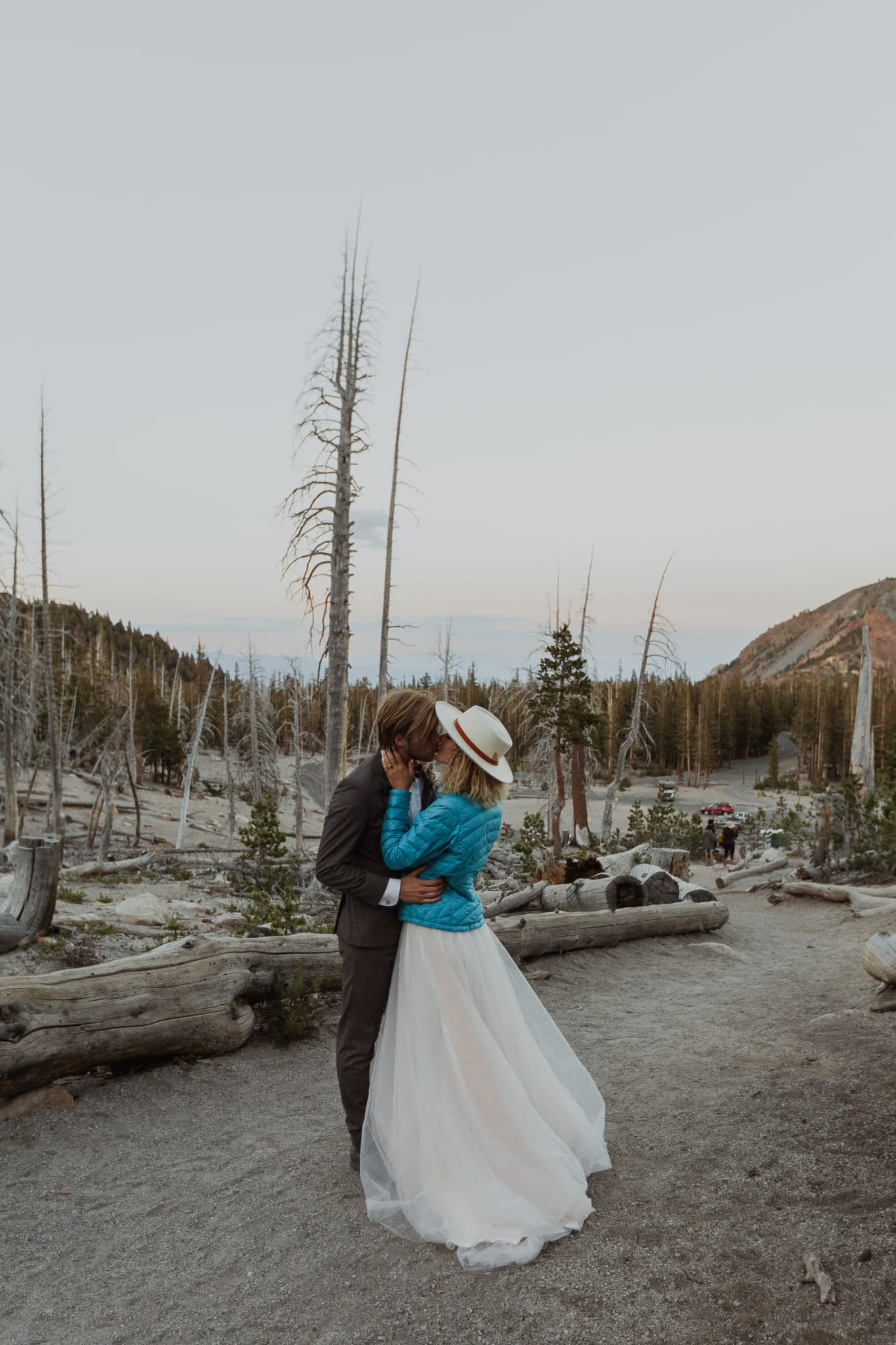 Tyler and Haylee share a kiss amidst dead trees by Horseshoe Lake.