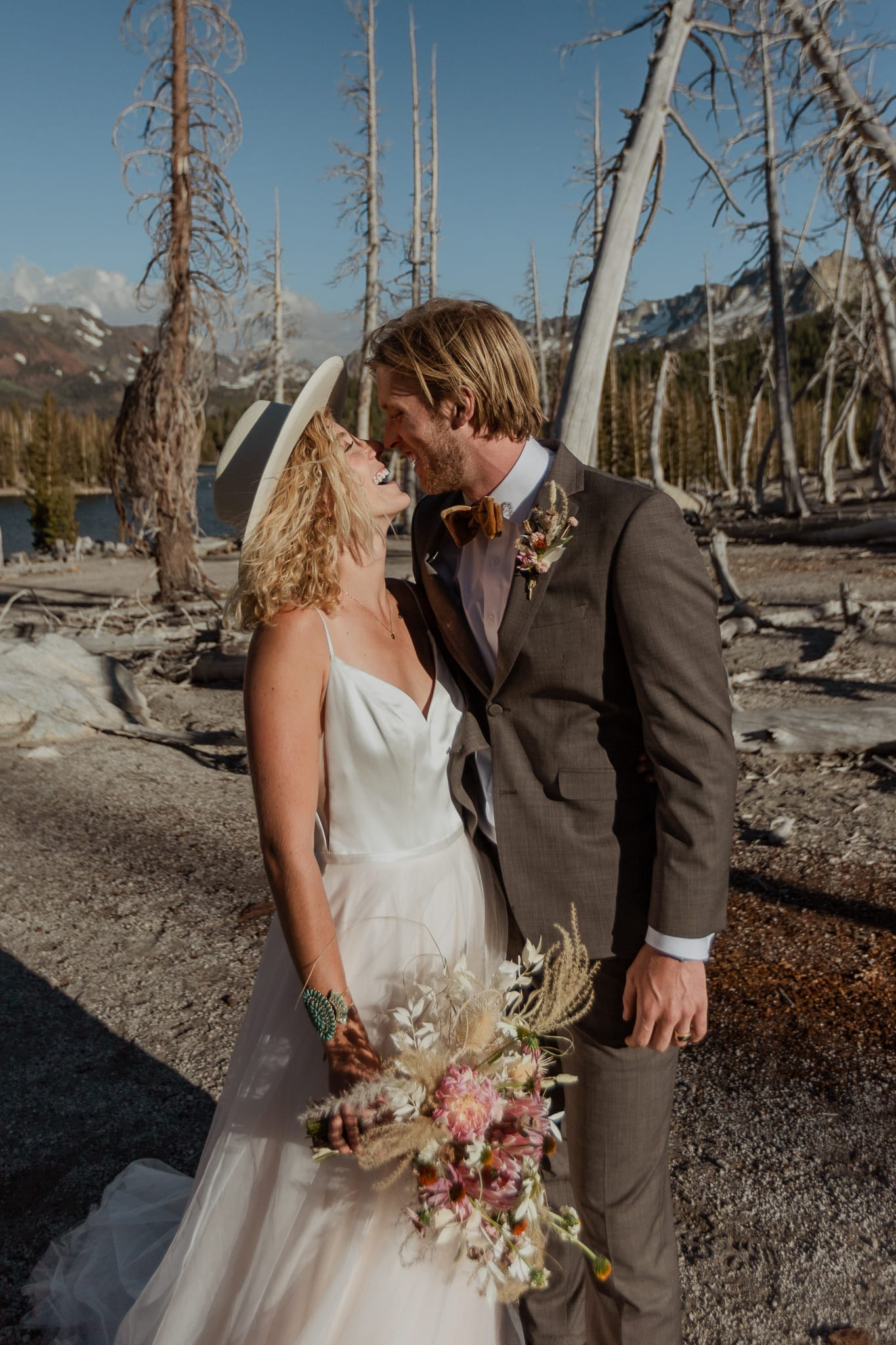 Tyler and Haylee hold each other close while laughing as they enjoy their adventure elopement and hike to McLeod Lake