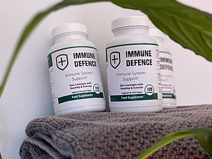 2 containers of immune defence support capsules on brown towel