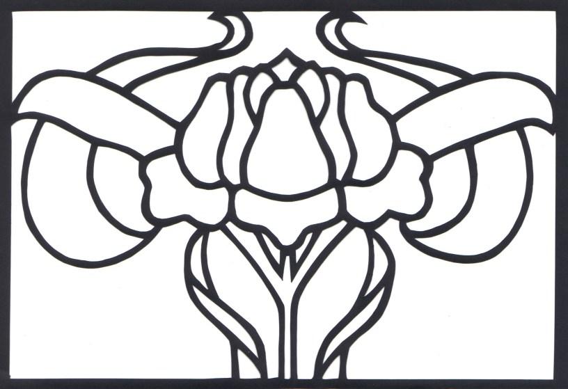 papercut of rose on black paper