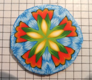 kaleidoscope-orange-green-blue-yellow-cane-k-vincent-polymer clay