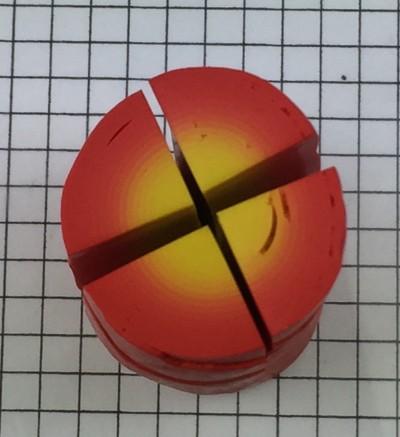 Cut the polymer clay bullseye cane into quarters
