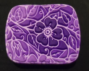 sutton slice polymer clay technique - covered tin