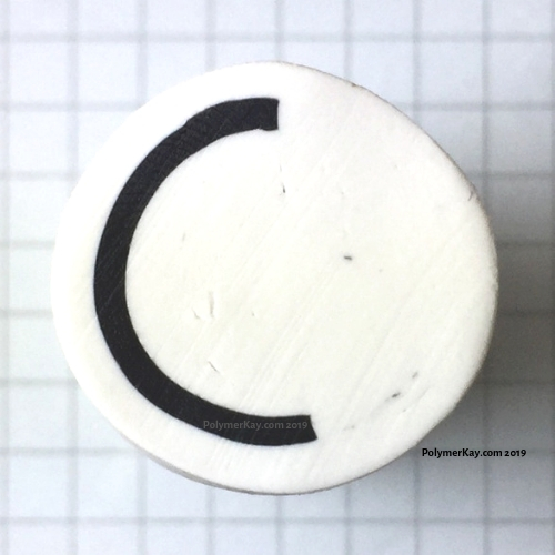 Letter C polymer clay cane with watermark