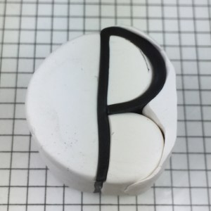 Letter P polymer clay alphabet cane tutorial - insert triangle into cane