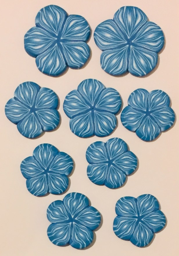 blue and white polymer clay flower button - assorted