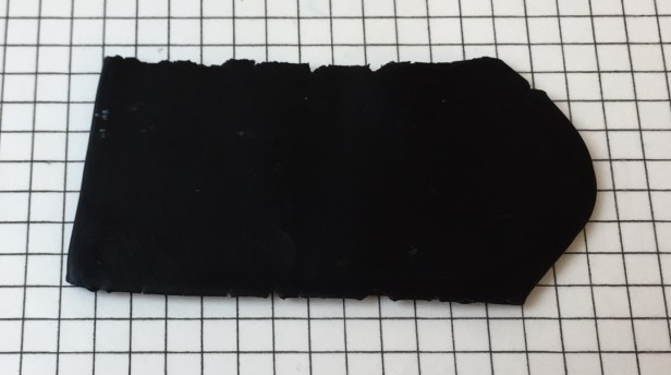 Letter V - black sheet of clay