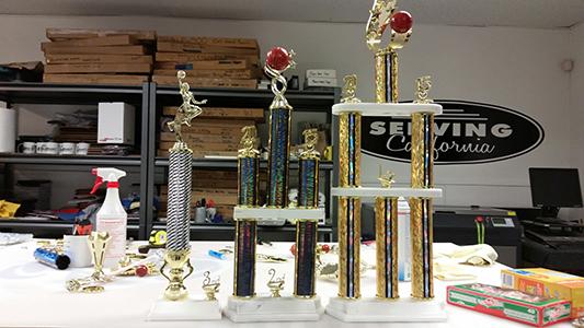 Three column trophies created by Kaz Bros Design Shop