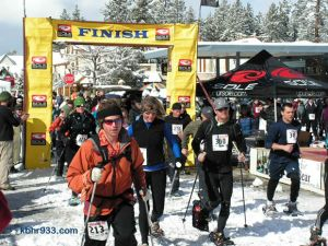 With fresh snow and sunny skies, the 10K gets underway in the Village.