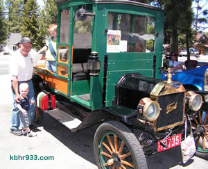 "All in the family: Stan O'Dell's 1914 Model T was a crowd favorite. Here, Stan is pictured with great-grandsons KJ and Kaden and the Model T which reads ""O'Dell and Sons""."