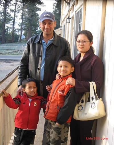 The Bhandari family in happier times: Kushan (in red) with father Keshar, mother Sujana, and big brother Kushal.