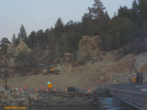 Though blasting is taking place near the dam, to accommodate the new Highway 18 bridge, plans are to preserve and/or renovate the historic damkeeper's house (at top left). The house was built in 1890, using hand-cut granite stone blocks, from the same quarry used for the 1884 dam.