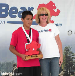 Thirteen-year-old Bobby Morales (with Event Director Beth Gardner) ran to a third overall finish in the 5K, just behind his BBHS cross-country coach.