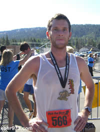 Nick Comiskey of Big Bear Lake, just after completing the half-marathon, which he won in 1:20.