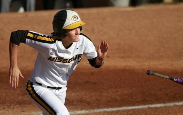 Taylor Gadbois tosses her bat and runs to first after getting one of Missouri's 16 hits against North Dakota State.