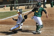 Missouri's Ashtin Stephens misses the plate in her slide and was tagged out by North Dakota State catcher Jenina Ortega.