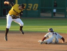 Missouri second baseman Shane Segovia attempts to grab a passed ball as Missouri State's Spencer Johnson advances to second. It wouldn't be enough, as Missouri would go on to beat the Bears 9-4 on Tuesday, April 8, 2014 at Taylor Stadium in Columbia, Mo.
