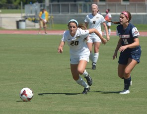 Missouri's Savannah Trujillo (20) chases after the ball against Lucy Pater (16) as Kaysie Clark (9) watches during the Tigers' 1-0 win over Tennessee-Martin on Sunday, Sept. 7, 2014, at Walton Stadium in Columbia, Missouri. She is one of seven freshmen on the team. (Greg Dailey)