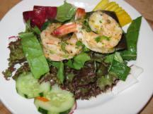 Salad with roasted shrimp.