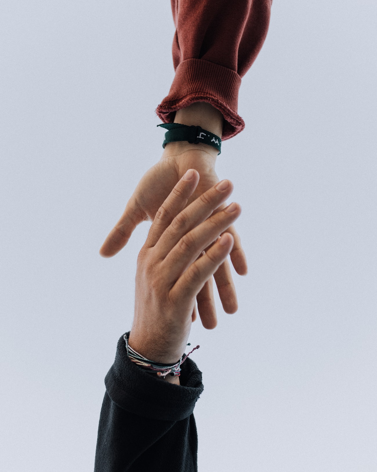 A hand reaching up to another hand
