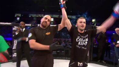 Andy Murphy gets his arm raised in the cage at BAMMA 28. Screenshot:UNILAD/BAMMA
