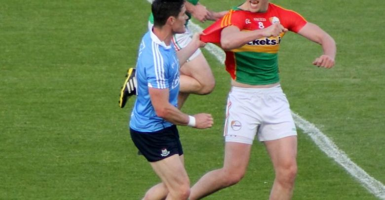 Brendan Murphy & Diarmuid Connolly tangle - Photo: Anne Lawlor