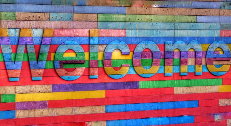 Welcome sign made of rainbow colored wood
