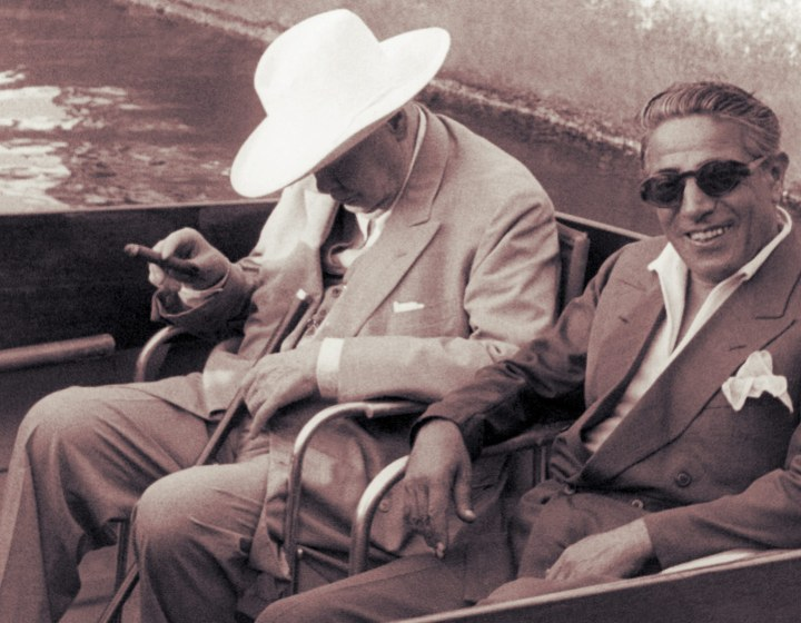 "Aristotle Onassis: ""Hurry! Take it before he wakes up. [laughs] Dude looks like Boss Hogg!"""