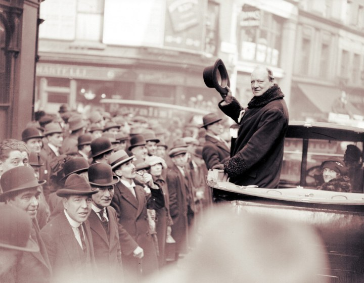I thought the hair was not part of his hat. Churchill's driver proceeds down the <em>left side</em> of the street. Embarrassing!