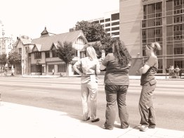 Hospital workers wait along the procession route during their lunch break.