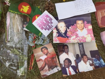 Photos and memories left at Ali's grevsite.
