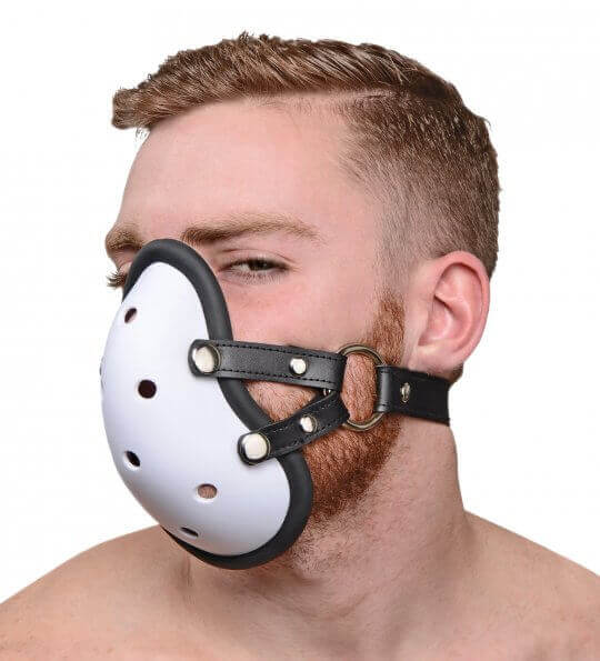Front view of a man wearing an athletic cup muzzle. White with venting holes.