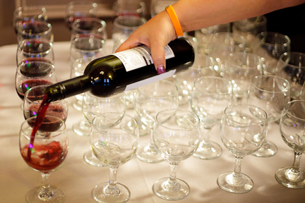 Top Shelf Bartender pouring wine at wedding reception