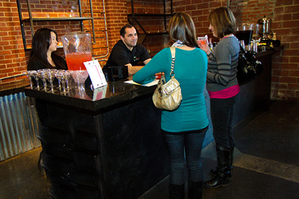 Top Shelf bartenders serving a casual event