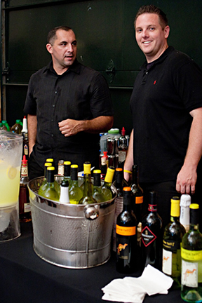 Top Shelf bartenders set up at event