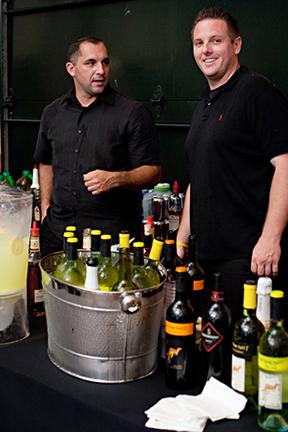 Top Shelf bartenders set up at event