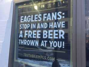 Sign reading Eagles fans: Stop in and have a free beer thrown at you! truthbarmpls.com