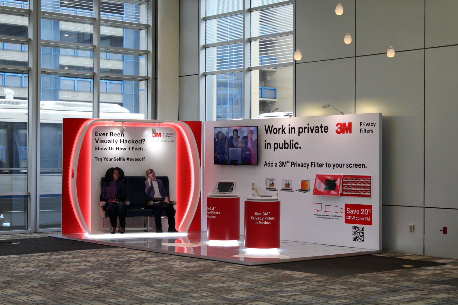 "Photo of a 3M Privacy Airport Experiential Booth with the headline ""Work in private in Public"""