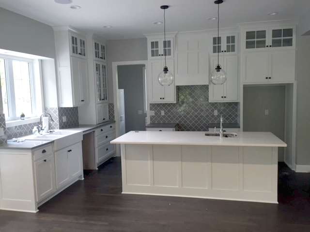 shaker style kitchen pull out faucet in overland park kansas kc wood custom cabinetry this beautiful white features full height upper wall with clear glass inserts on top mullions