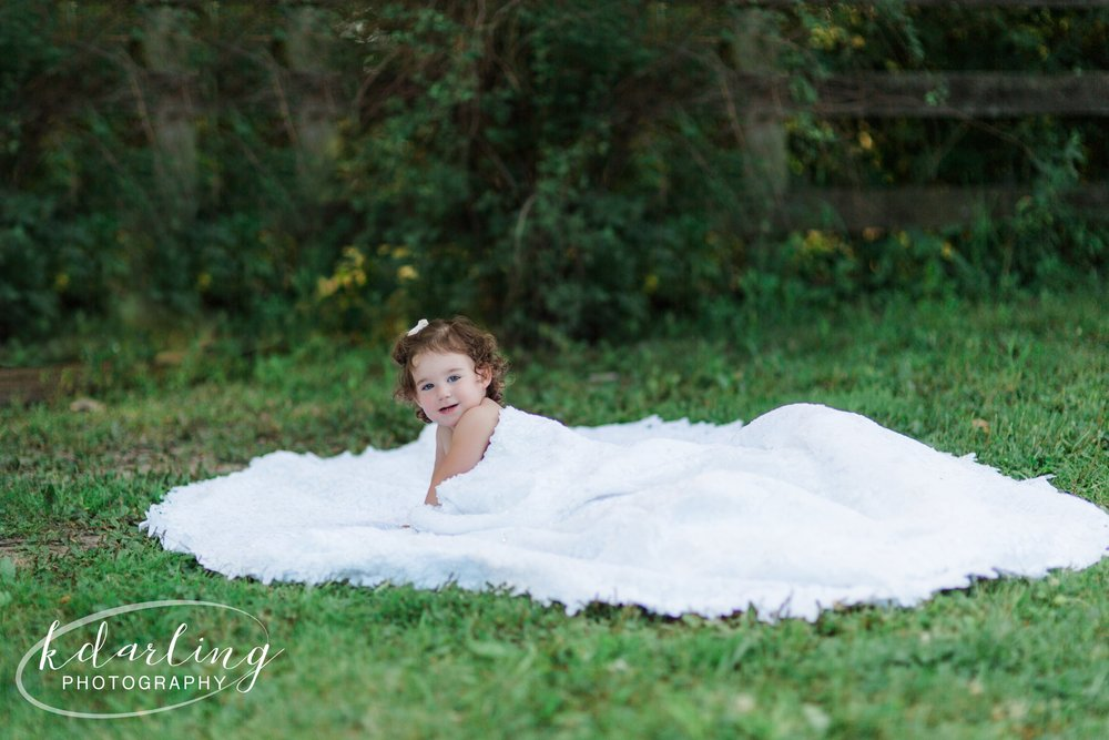 2 year old in mom's wedding dress