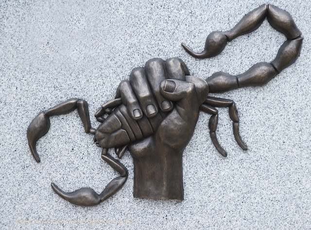Scorpion and Clenched Fist motif as seen on a brigader cap badge was used by sculptor Charlie Carter for the memorial.