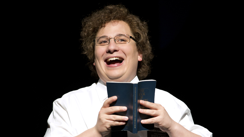 """Jared Gertner playing Elder Cunningham at the """"Book of Mormon"""" premiere in Denver."""