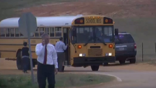 Police investigate at the scene of an attack that killed a bus driver and saw a kindergartener taken hostage in Midland City, Ala. (Photo: CNN)
