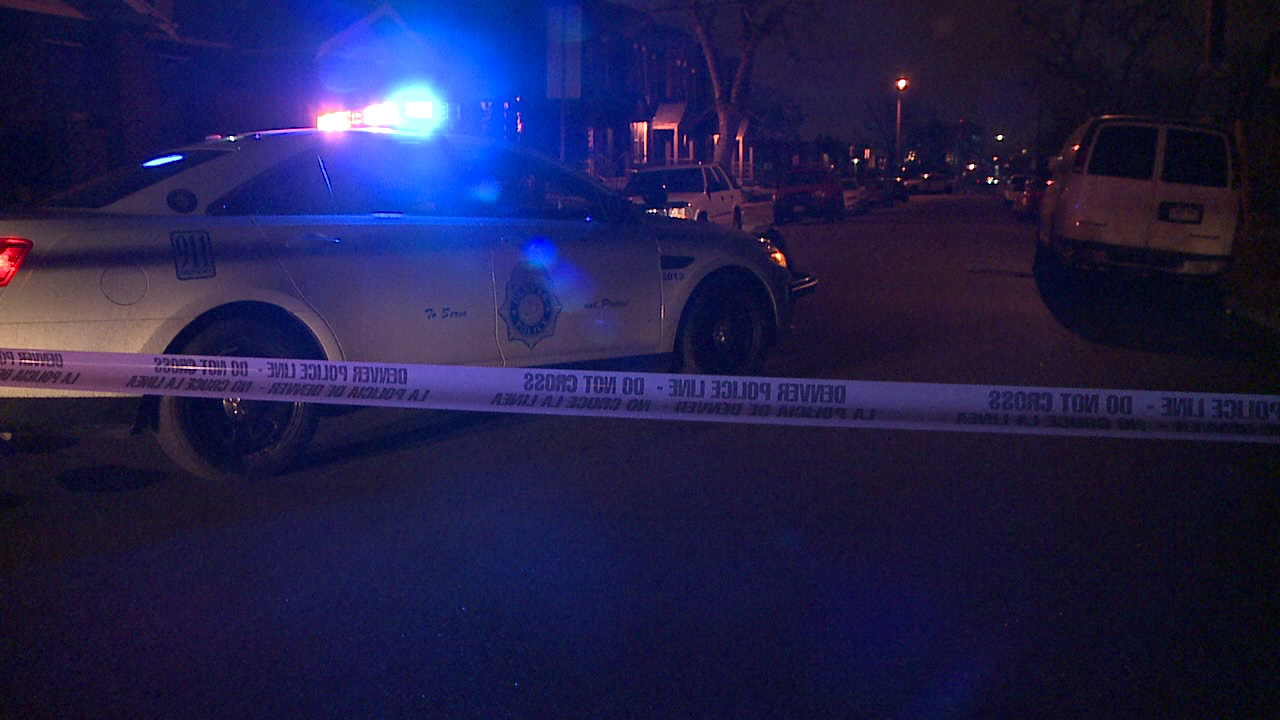 Police investigate at the scene of a shooting that left one dead in northwest Denver on April 1, 2013.