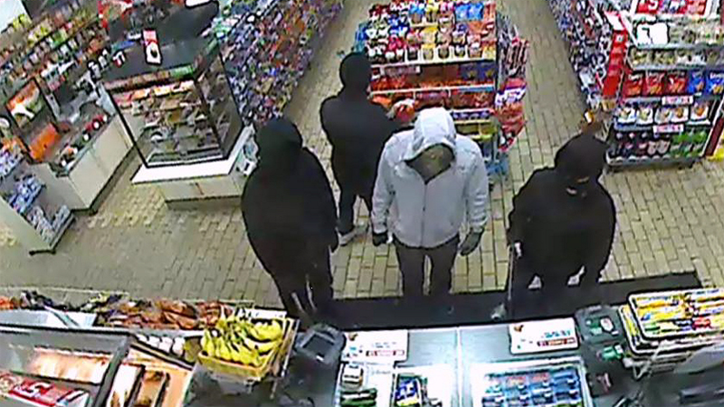 Surveillance image of suspects wanted in a string of street and store robberies. The image is from a 7-Eleven at 2790 S. Wadsworth Blvd. Sunday, February 9, 2014