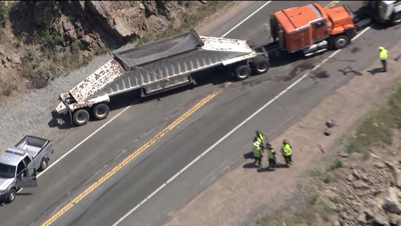 A gravel truck overturned on Highway 6 in Clear Creek Canyon on July 1, 2014. (Photo: Skyfox)