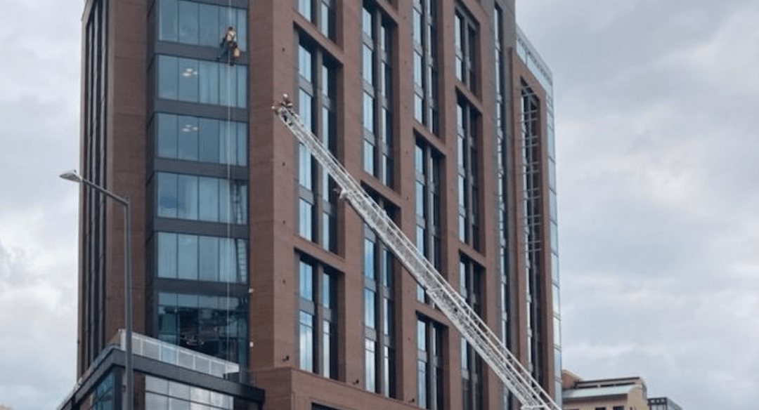 A window washer is rescued from a building in Denver's Lower Downtown neighborhood on March 12, 2021. Credit: Denver Fire Department