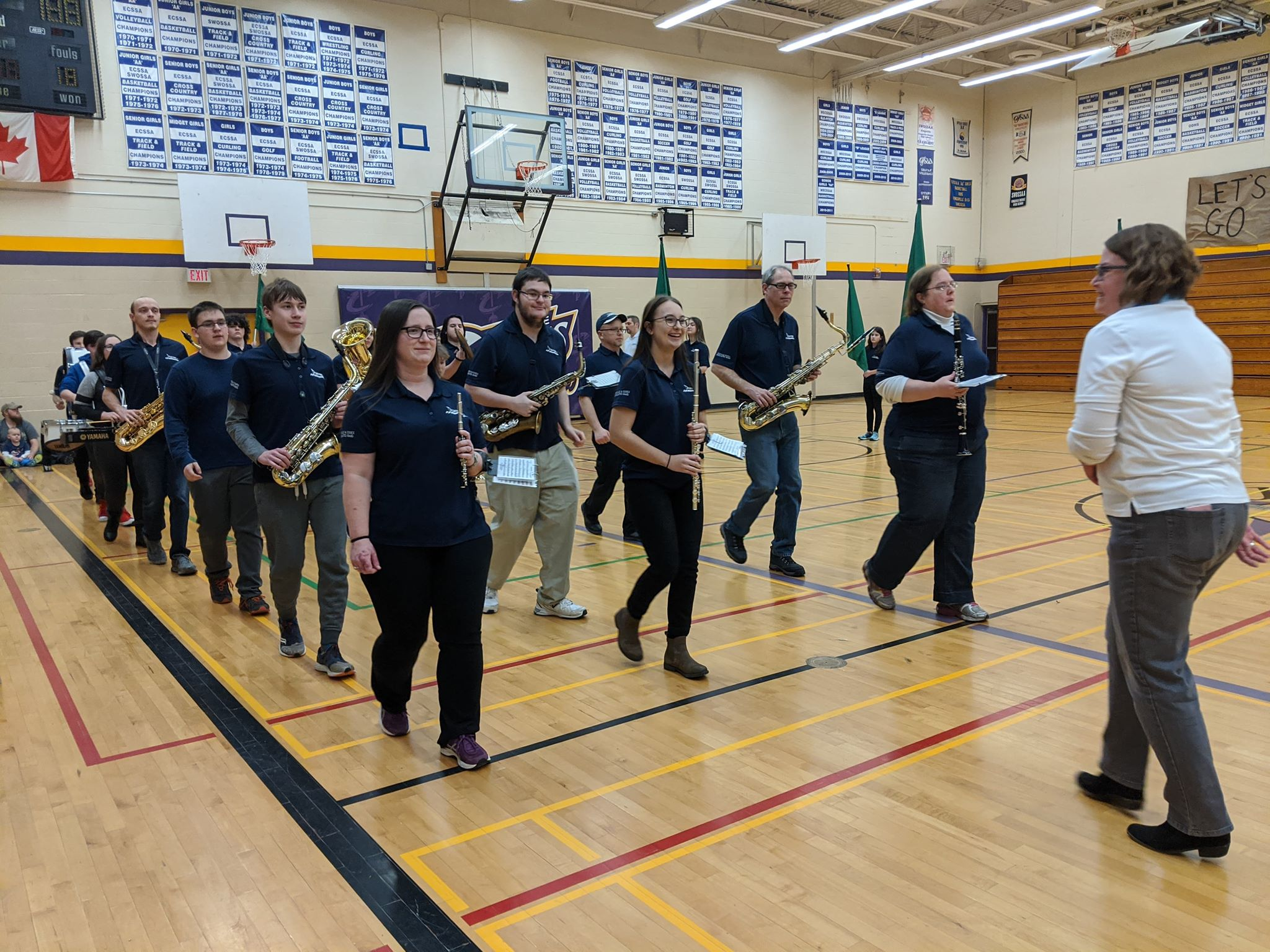 marching band practicing marching through a gymnasium