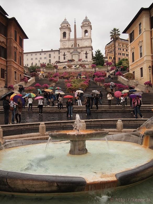 Fountain in the Piazza di Spagna and the Trinità dei Monti in the Rain