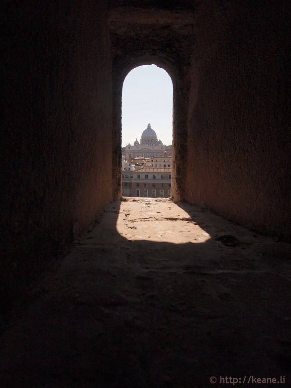 St. Peter's Basilica through a window at Castel Sant'Angelo in Rome